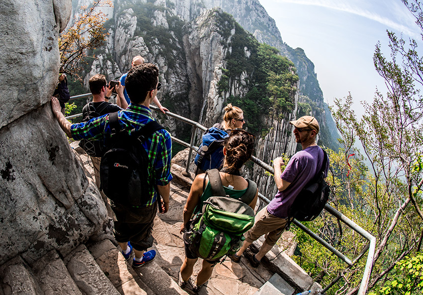 Hiking along the cliff-side trails of Mount Song, one of China's Five Great Mountains.